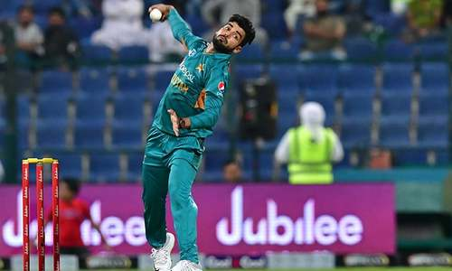 Shadab Khan bowls a ball during the first T20 cricket match between Pakistan and New Zealand. — AFP