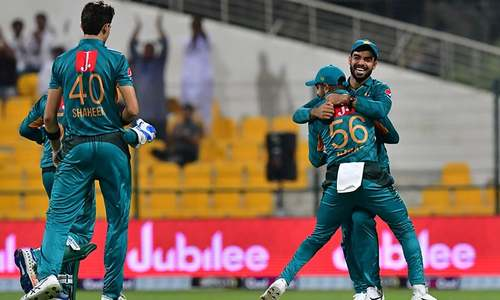 Pakistan cricketers celebrate after New Zealand's cricketer Colin de Grandhomme is dismissed. — AFP