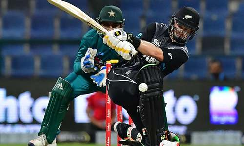 Colin Munro plays a shot as Pakistan's wicketkeeper Sarfraz Ahmed looks on. — AFP