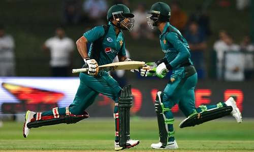 Fakhar Zaman and Babar Azam run between the wickets. — AFP