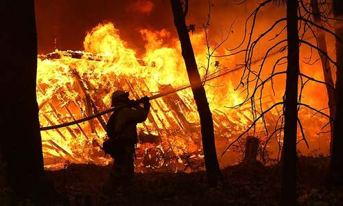 9 dead in California wildfires, tens of thousands forced to flee