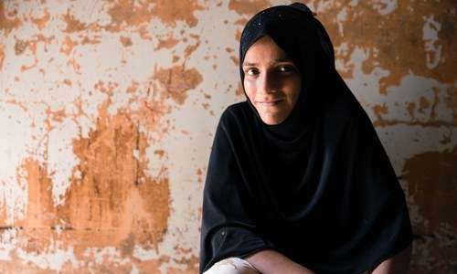 Saba is one of almost 22.5 million children who are out of school. She sells potatoes on the street outside a private school and longs to attend school herself. *Image by Insiya Syed for Human Rights Watch*