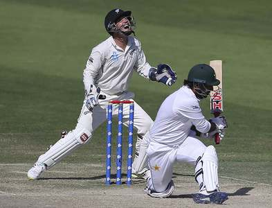 Sarfaraz Ahmed in action against New Zealand. — AP