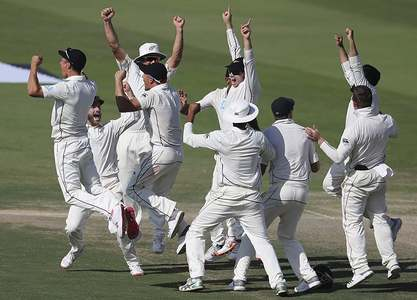 New Zealand's players celebrate after they beat Pakistan in their test match in Abu Dhabi. — AP