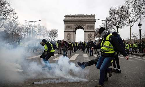 Barricades burn as new 'yellow vest' protests hit Paris