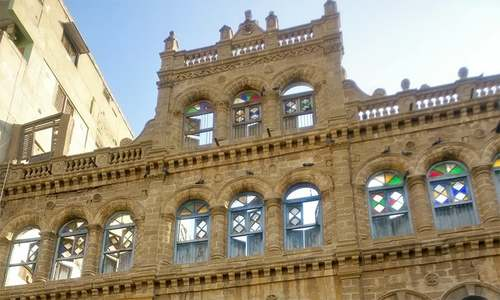 How was the Kanji building, a listed heritage site in Karachi, demolished?
