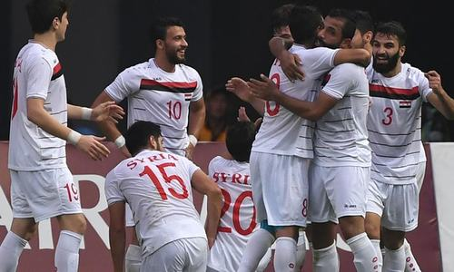 Syria take field in Asian Cup with fans divided by war