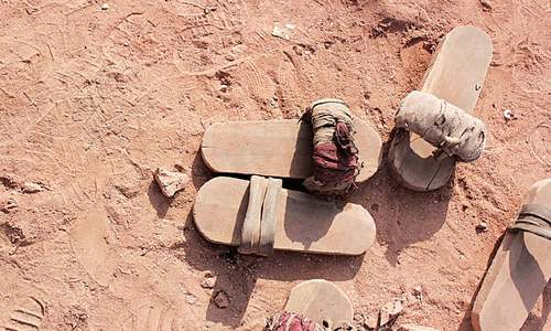 The wooden slippers that bonded labourers wear while working lie near the spot where Shahzad and Shama Masih were burnt alive in Rosa Tibba village, Kot Radha Kishan.—Photo by writer