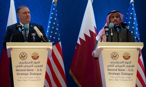 Pompeo and the Qatari foreign minister hold a joint press conference in Doha. —AFP