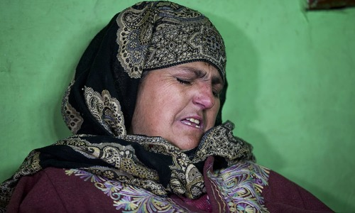 In this Dec 26, 2018 photo, Fareeda Rasheed, mother of Kashmiri boy Mudassir Rashid Parray grieves inside her house in Hajin village. — AP
