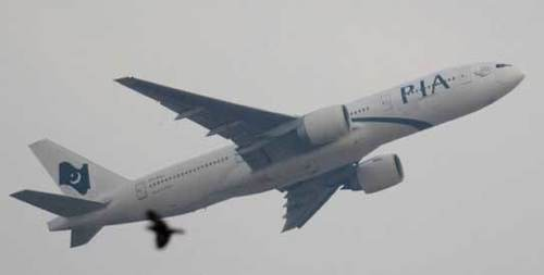 PIA plane escapes being hit by mysterious drone