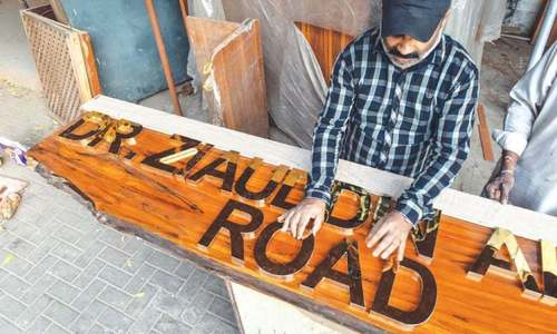 What's the story behind the new signboards around downtown Karachi?