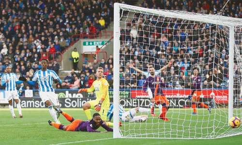 City boss Guardiola 'demands more' after Huddersfield stroll