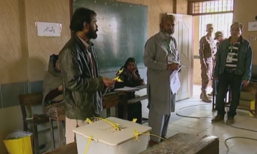 Officials and voters are seen inside a polling station during the PS-94 by-election. — DawnNewsTV