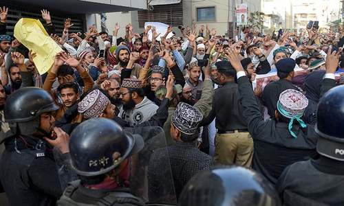Dozens detained as police use batons, tear gas to disperse violent TLP protest in Karachi