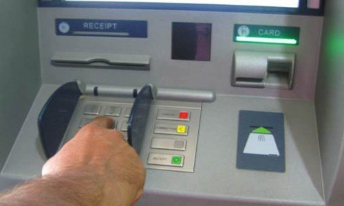 Chinese man caught 'stealing' money from ATM
