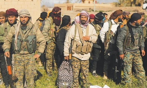 Militants, civilians quit IS holdout in east Syria