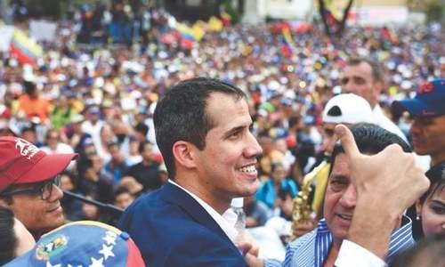 Venezuela's Guaido tells Maduro pressure 'just beginning'