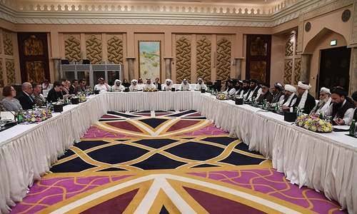 In this handout file photo taken on February 26, 2019 released by the official Qatar's Ministry of Foreign Affairs, Qatari officials (C) take part in meeting between US special envoy Zalmay Khalilzad (2nd-L), the US delegation, Sher Mohammad Abbas Stanikzai (6th-R) and the Taliban delegation, in Doha. — AFP