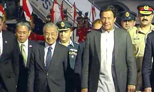 PM Khan receives Malaysian premier Dr Mahathir at Nur Khan airbase