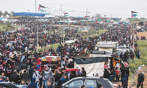 Tens of thousands mass at Gaza border to mark protest anniversary