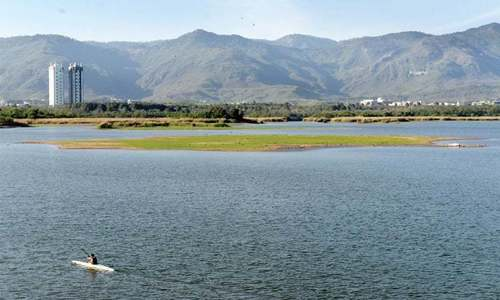 Active rainfall fills Rawal Lake to capacity