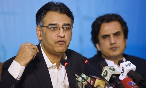 Asad Umar addresses press conference after stepping down as finance minister