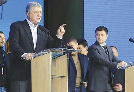 Ukraine's vote rivals clash in stadium debate