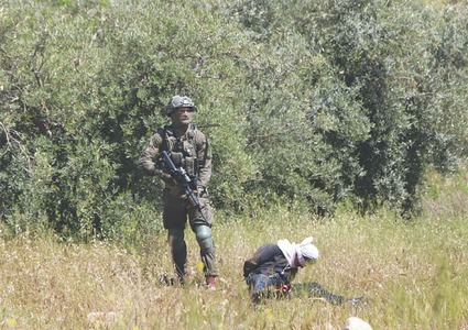 Israeli troops accused of shooting at handcuffed Palestinian