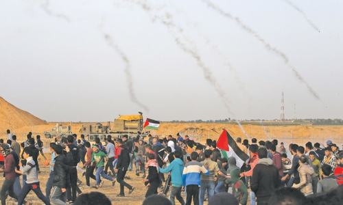 60 Palestinians hurt in Gaza border clashes
