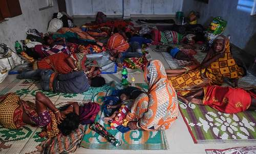 People evacuated for safety rest in a temporary cyclone relief shelter in Puri in the eastern Indian state of Odisha on May 3, as cyclone Fani approaches the Indian coastline. — AFP