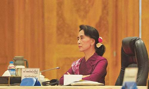 Suu Kyi tries to save face with Myanmar reporters' release