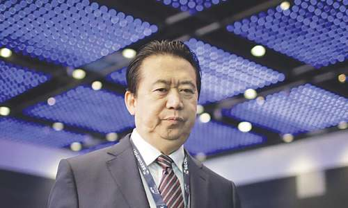China indicts former Interpol chief on bribery charges