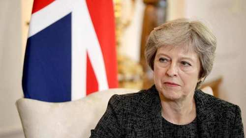 Embattled May dangles promise of new Brexit vote