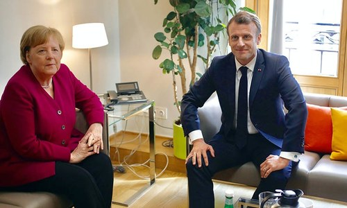 Macron confronts Merkel as fight for top EU job begins