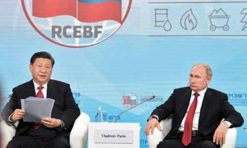 Putin, Xi hit back at US dominance at Russia economic forum