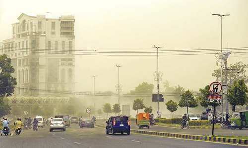Dust storm, scattered rain break heat spell in Lahore