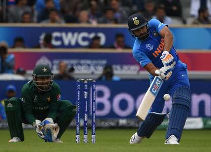 Sharma pictured playing a stroke in the Indo-Pak match. — AFP