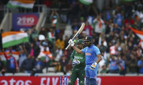 Rohit Sharma celebrates reaching a half century during the Cricket World Cup match between India and Pakistan at Old Trafford. — AP