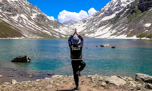 In pictures: Mirror-like Izmis glacial lake draws tourists to Utror valley