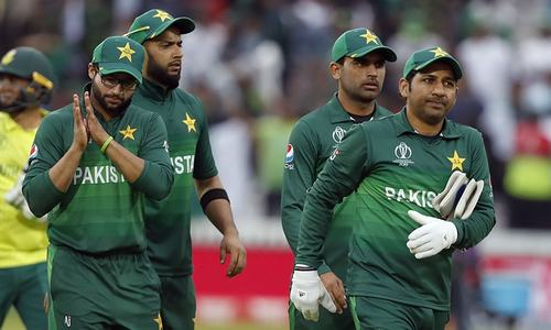 Sarfaraz Ahmed leads the team from the field as they celebrate after they defeated South Africa. — AP