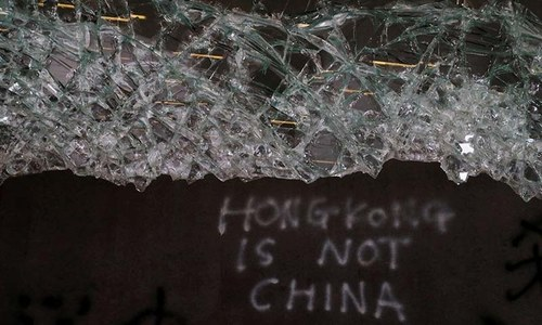 Hong Kong protesters storm legislature in direct challenge to China