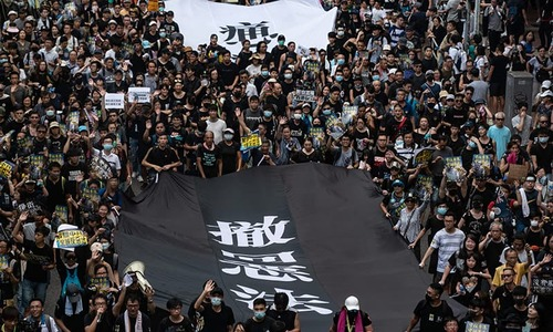 Hong Kong protesters march in new outpouring of grievances