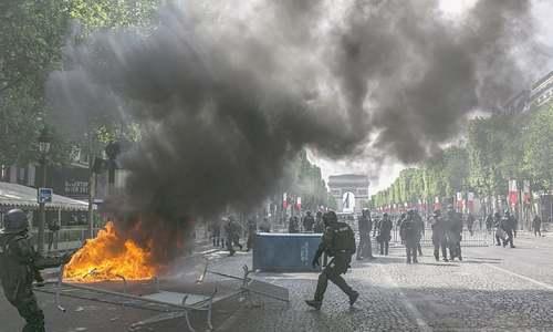 Violent clashes tarnish Bastille Day parade