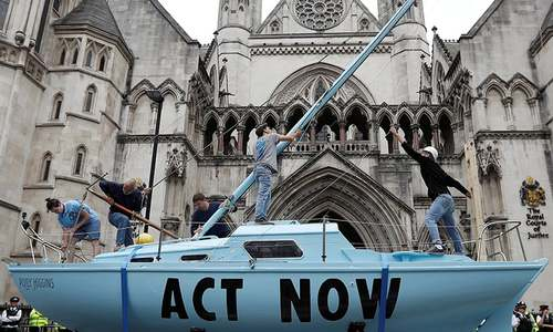 Climate activists disrupt British cities with 'non-violent civil disobedience'