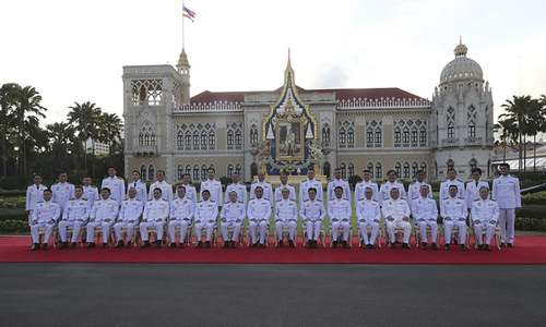 Thai king swears in coup leader's cabinet