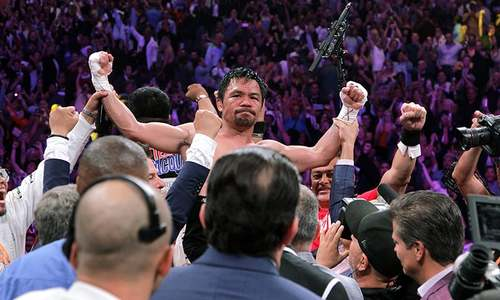 Brilliant Pacquiao downs Thurman, becomes oldest boxer to capture WBA crown