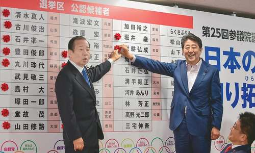 Abe claims victory in upper house election