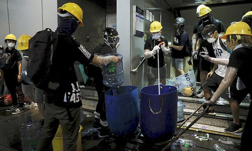 Tear gas, rubber bullets fired at Hong Kong protesters near China office