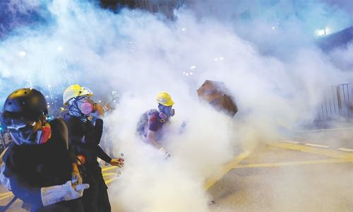Hong Kong protesters seize roads in defiance of China warnings